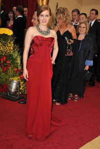 So close!  I LOVE me a red dress, but the carpet matching hurts.