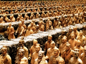 My latest theory is that these guys were in line to register their horses, died of waiting, and were fossilized thus. Emporer Qin had a long ways to go with imperial management.