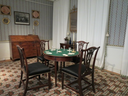 Georgian card table in a parlor.